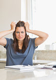 Woman feeling angry about  bills