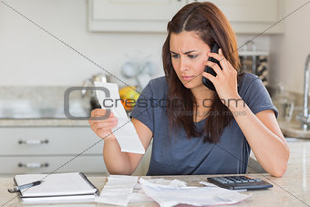 Woman calling while calculating