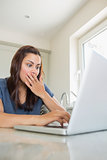 Surprised woman using the laptop