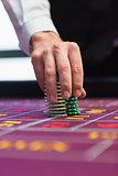 Dealer placing chips on table