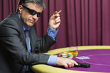 Man with gun at poker table