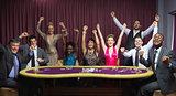 Cheering group at poker table