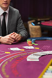 Man sitting at poker table with cards and chips