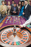 People standing at the roulette