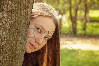 portrait of young teenager girl in park