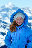 Happy girl portrait on winter  mountain background.