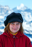 Happy woman portrait on winter  mountain background.