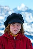 Happy woman portrait on winter  mountain background.