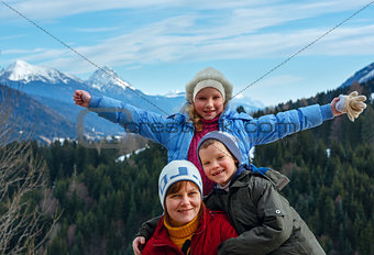 Family and winter mountain landscape