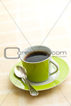 black coffee in green cup