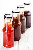 various barbecue sauces in glass bottles