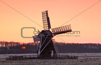 Charming Dutch windmill during sunset