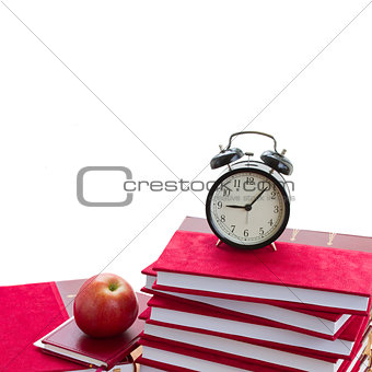 alarm clock on pile of books