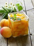 Peach (apricot) jam in a glass jar
