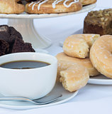 Continental breakfast buffet table setting with coffee and pastry
