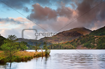 Sunrise landscape over Llyn Gwynant to Yr Afan mountain in Snowd
