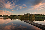 Beautiful sunset over Autumn Fall lake with crystal clear reflec