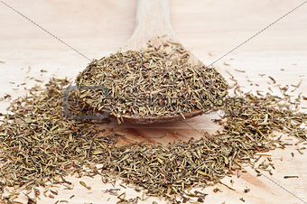 Thyme on wooden serving spoon with selective focus