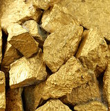 gold nuggets many pieces as the background