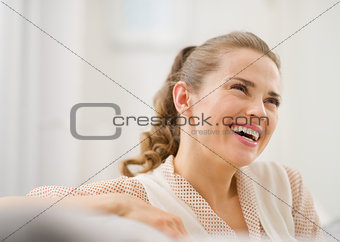Portrait of happy young woman in living room