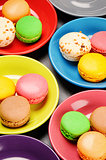 French macaroons in colorful plates