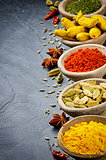 Colorful mix of spices on stone background