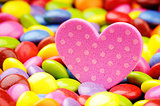 Pink heart and colorful smarties