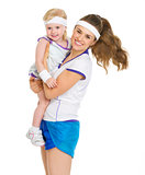 Portrait of happy mother and baby in tennis clothes