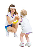 Mother and baby in tennis clothes playing tennis