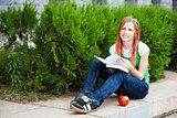 student with books and apple