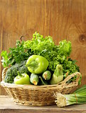 various green vegetables (peppers, broccoli, cucumbers, green onions, lettuce)