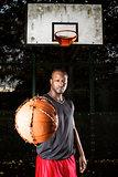 Basketball player on the outdoor basketball court.