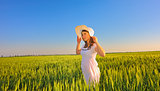 beautiful girl with hat in the field