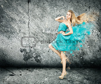 Woman in Splashing Turquoise Dress