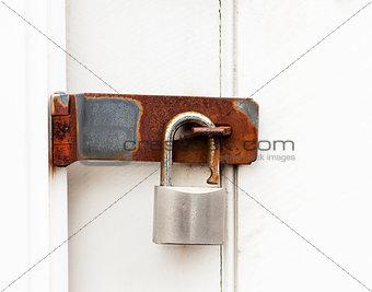 padlock on wooden door