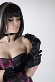 Goth girl in purple corset and black gloves