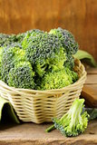 fresh raw green cabbage broccoli in a wicker basket