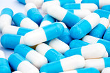 Set of white blue tablets as a background on medical subjects
