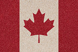 Canadian flag made of colored decorative sand.