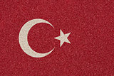 Turkish flag made of colored decorative sand.