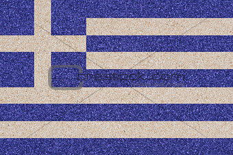 Greek flag made of colored decorative sand.