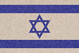 Israeli flag made of colored decorative sand.