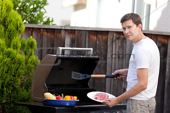 man grilling food