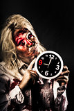 Late zombie woman holding clock. Passing time