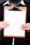 Businessman conducting survey with blank clipboard