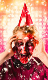 Zombie in party hat. Halloween party celebration
