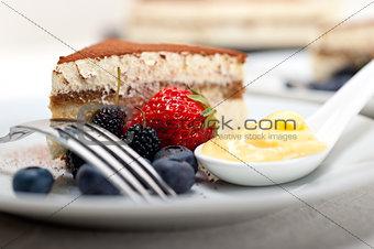 tiramisu dessert with berries and cream