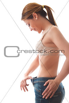 woman looking at loose fitting cloth on white background