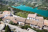 Guadalest lake and village. Reservoir and tiling roofs.