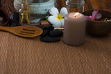 tropical spa setup with frangipani flower hot rocks and massage